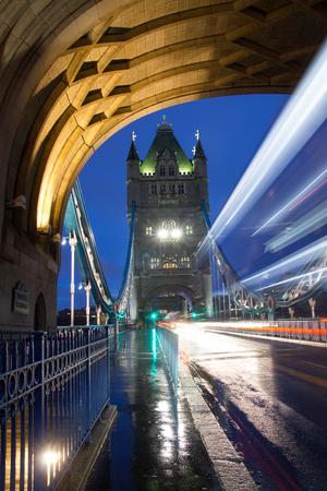 Tower Bridge in London during dusk in December with a bus blur