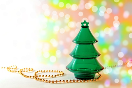 Plastic toy christmas tree with golden beeds ona colorful bokeh background Stock Photo - 11564324
