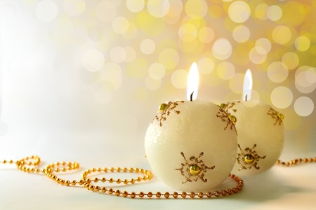 shimmery: Christmas card, two lit festive golden candles, on a white background, bokeh, shallow depth of field Stock Photo