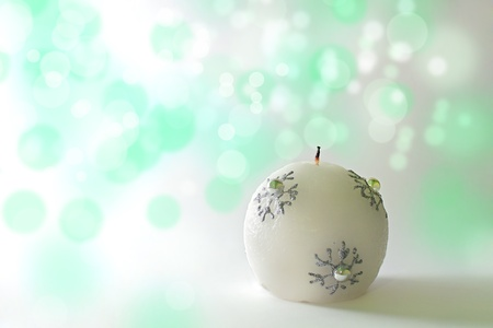 Christmas card, christmas candle on a green bockeh background photo