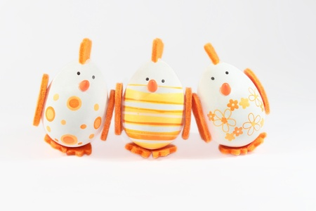 Cute Easter eggs - Happy Easter card; Cute funny looking Easter eggs looking up, Easter background, isolated photo