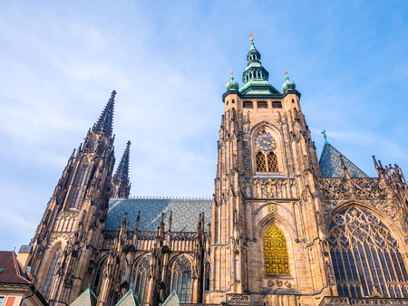 St. Vitus cathedral in Prague Castle front view of the main entrance in Prague, Czech Republic.Blue sky sunny background winter season.Landmark historical destination travel. Stock Photo