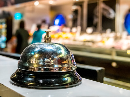 call bell service vintage bokeh background in restaurant and supermarket space colorful people blur. 免版税图像 - 101410054