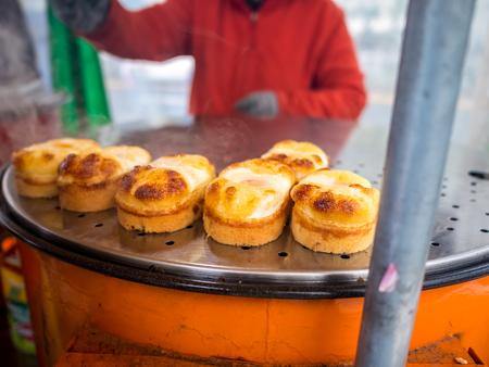 Egg bread Korean street food snack, egg cake,cheese also known as gyeran-ppang, found in Seoul, South Korea Banco de Imagens