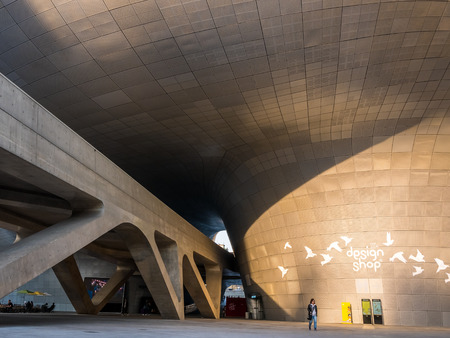 Seoul, South Korea - April 16, 2018: People and touristor visits Dongdaemun Design Plaza (DDP). The newest and most iconic landmark of the Korean design industry with modern interior curve shape archi