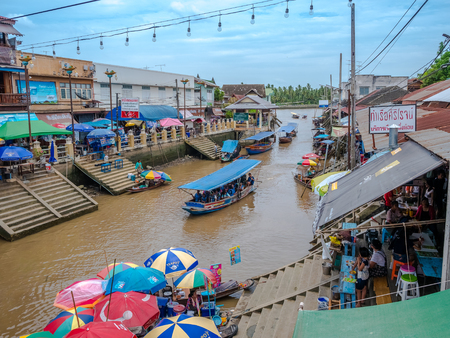 THAILAND, SAMUTSONGKHRAM - JUNE 17: Traditional thai steet food at Amphawa floating market in Thailand.Amphawa floating market canal. Amphawa floating market is a famous place to shopping and eating.