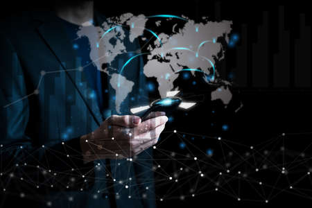Business and technology concept background with businessman using mobile analyzing data and economic with network connection on modern virtual interface.Business strategy.Abstract icon.