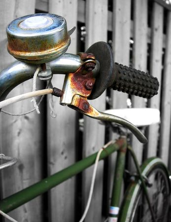 leaned: Rusty Bicycle leaned against fence