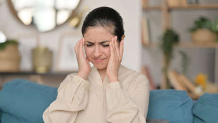 Portrait of Indian Woman having Headache at Home