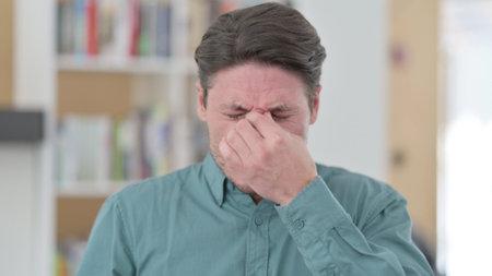 Middle Aged Man having Headache and Eye Strain