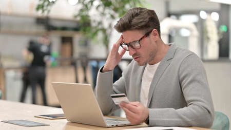 Middle Aged Man having Online Payment Failure on Laptop Stock Photo