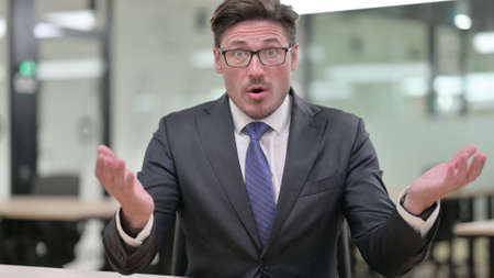 Portrait of Middle Aged Businessman reacting to Loss, Failure