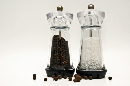 salt and pepper in a glass container photo