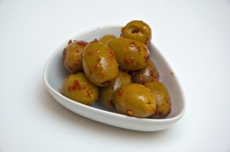 tasty, healthy, marinated olives in a ceramic salad bowl photo