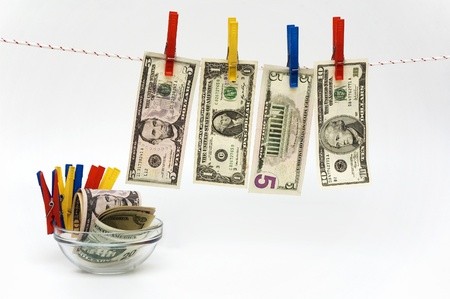 spanned: photoshoot with banknotes, rope and clothespins