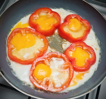 fried eggs with bread and vegetables photo