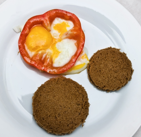 fried eggs with bread and vegetables