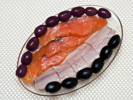fish herring on board with the onion and olives