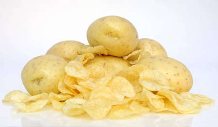 fresh potatos surrounded by fried chips