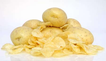 potatos: fresh potatos surrounded by fried chips
