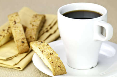 A cup of coffee and a readitional biscotti Stock Photo - 7782018