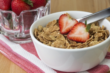 abowl of healthy breakfast cereal and strawberries