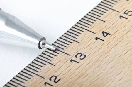 precise: ruler and pencil on the white background extreme closeup