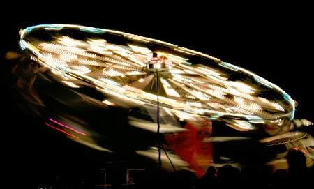 rotating fair ride at night with long exposure photo