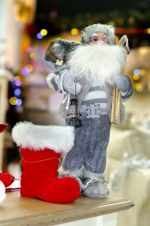 Christmas and new year decoration with Santa Claus and red present sock photo