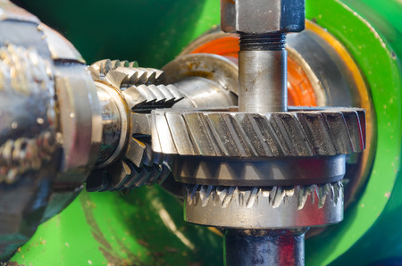 industrial machine for wormwheel gear and cogwheel production and service, rotating gears extreme closeup view photo