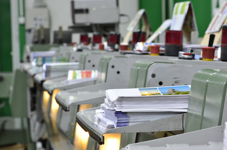 book, magazine production line into press plant house. Binding product. Stock Photo
