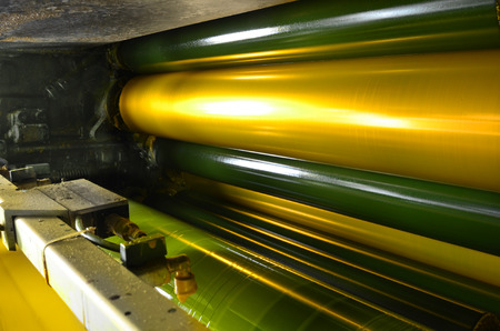 print machine, yellow color drum, dramatic light photo