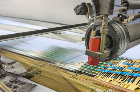 offset up: print sheet is loade in folding macnihe, detail close up Stock Photo