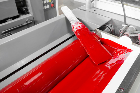 offset: Image of processred ink in the fountains and on the rollers of a four color printing press Stock Photo
