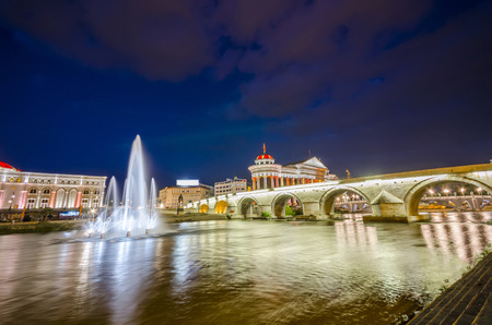 statutes: Macedonians capital city Skopje. Old stone bridge
