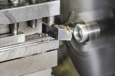 turning operation: lathe machine metal workshop. industrial aluminum peeling closeup