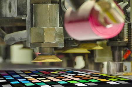 offset machine press print run at table; color patch detail photo