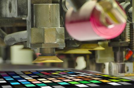 offset machine press print run at table; color patch detail Фото со стока - 30386348
