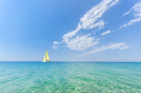 horizon over water: Ocean View. Endless sea, infinite horizon, blue green sea super clean waters and blue skies separated by a far away horizon. Stock Photo