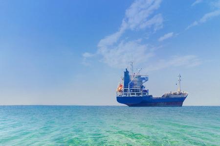 Tanker ship at sunrise.tanker at open sea horizon photo