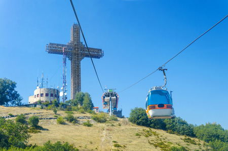Millenium Cross on a top of the Vodno mountain hill above Skopje, Macedonia and cable cabin lift photo