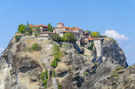 panoramatic: Meteora Monasteries in Greece on the top of mountain geological rocks, stone built