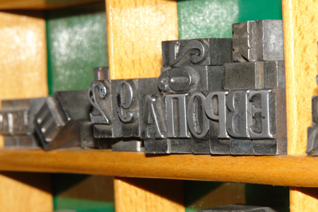 cast metal type: Typography letters shelf  old metallic letters for printing