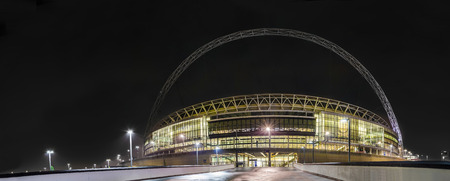 Wembley stadium Arch - Stock Image  London, England - December 17, 2011  The Arch of the new Wembley stadium located at Wembley park in London It started to function at 2007 and was built at the place of the old Wembley stadium Many famous singers and gro Редакционное