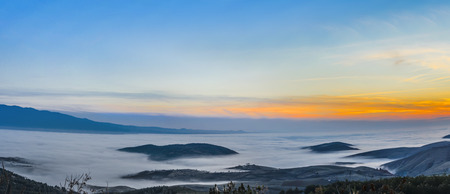 fog and cloud mountain valley landscape sunset sky photo