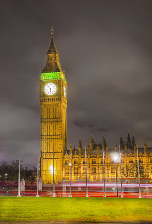 Big Ben at dramatic colorful night sky with light trails, London, England photo