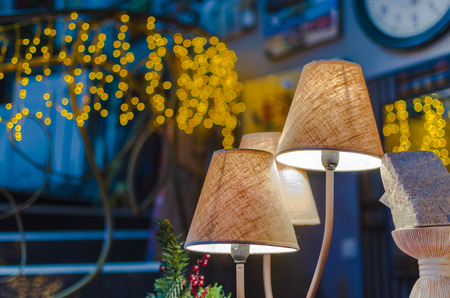 lamp shade: modern vibrant table lamp and christmas lights at background Stock Photo