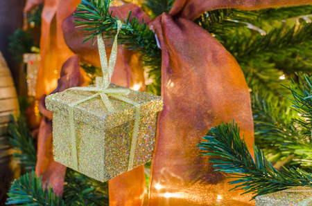 gold box christmas presents under the new year tree with ribons photo
