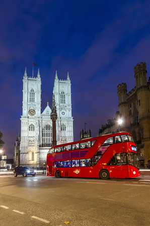 Twilight view of Westminister Abbey catedral with doubledecker bus, London, United Kingdom