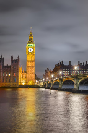 Amazing twilight vertical view of Westminister bridge, Big Ben and House of Parlament, London, United Kingdom photo